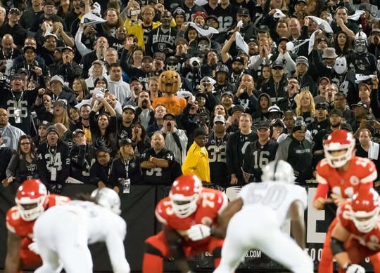 Oct 19, 2017; Oakland, CA, USA; A fan in a pumpkin mask in the stands during the third quarter between the Oakland Raiders and the Kansas City Chiefs at Oakland Coliseum. Mandatory Credit: Kelley L Cox-USA TODAY Sports