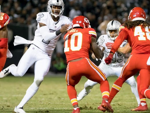 Oct 19, 2017; Oakland, CA, USA; Oakland Raiders punter Marquette King (7) tackles Kansas City Chiefs wide receiver Tyreek Hill (10) on a punt return during the third quarter at Oakland Coliseum. Mandatory Credit: Kelley L Cox-USA TODAY Sports