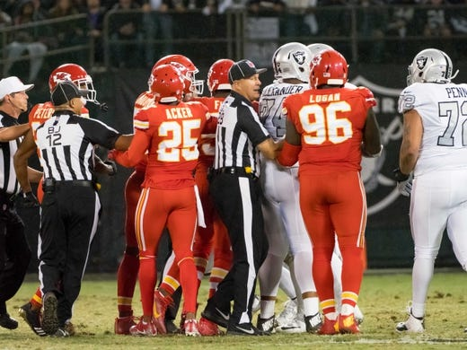 Oct 19, 2017; Oakland, CA, USA; Referees break up an altercation between the Oakland Raiders and the Kansas City Chiefs during the second quarter at Oakland Coliseum. Mandatory Credit: Kelley L Cox-USA TODAY Sports