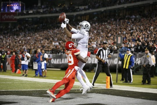 Oct 19, 2017; Oakland, CA, USA; Oakland Raiders wide receiver Michael Crabtree (15) is unable to make a catch in the end zone over the top of Kansas City Chiefs cornerback Terrance Mitchell (39) in the third quarter at Oakland Coliseum. The Raiders defeated the Chiefs 31-30. Mandatory Credit: Cary Edmondson-USA TODAY Sports
