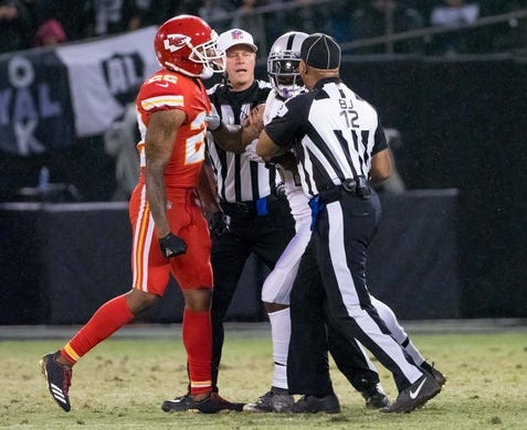 Oct 19, 2017; Oakland, CA, USA; Referees break up an altercation between the Kansas City Chiefs cornerback Marcus Peters (22) and Oakland Raiders running back Marshawn Lynch (24) during the second quarter at Oakland Coliseum. Mandatory Credit: Kelley L Cox-USA TODAY Sports