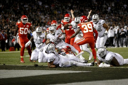 Oct 19, 2017; Oakland, CA, USA; Oakland Raiders running back DeAndre Washington (33) scores a touchdown against the Kansas City Chiefs in the third quarter at Oakland Coliseum. The Raiders defeated the Chiefs 31-30. Mandatory Credit: Cary Edmondson-USA TODAY Sports