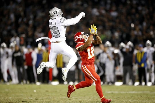 Oct 19, 2017; Oakland, CA, USA; Kansas City Chiefs wide receiver Albert Wilson (12) prepares to catch a touchdown off a deflected pass by Oakland Raiders strong safety Keith McGill (39) in the third quarter at Oakland Coliseum. The Raiders defeated the Chiefs 31-30. Mandatory Credit: Cary Edmondson-USA TODAY Sports
