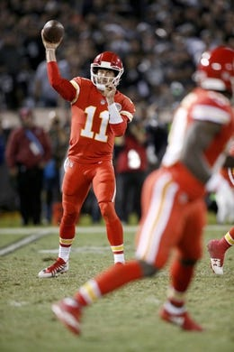Oct 19, 2017; Oakland, CA, USA; Kansas City Chiefs quarterback Alex Smith (11) throws a pass against the Oakland Raiders in the third quarter at Oakland Coliseum. The Raiders defeated the Chiefs 31-30. Mandatory Credit: Cary Edmondson-USA TODAY Sports