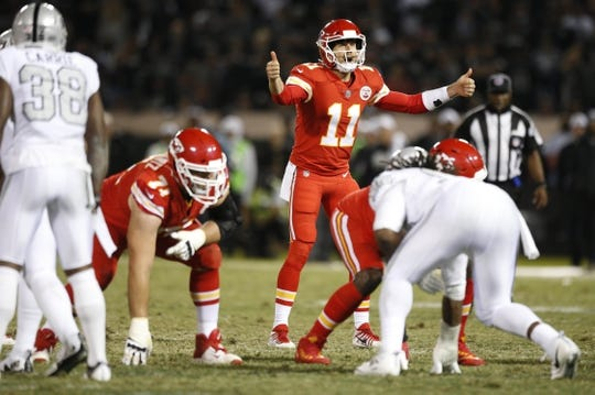 Oct 19, 2017; Oakland, CA, USA; Kansas City Chiefs quarterback Alex Smith (11) calls a play against the Oakland Raiders in the third quarter at Oakland Coliseum. The Raiders defeated the Chiefs 31-30. Mandatory Credit: Cary Edmondson-USA TODAY Sports