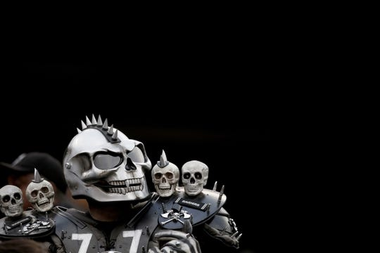 Oct 19, 2017; Oakland, CA, USA; An Oakland Raiders fan looks towards the scoreboard during a break in the action against the Kansas City Chiefs in the first quarter at Oakland Coliseum. The Raiders defeated the Chiefs 31-30. Mandatory Credit: Cary Edmondson-USA TODAY Sports
