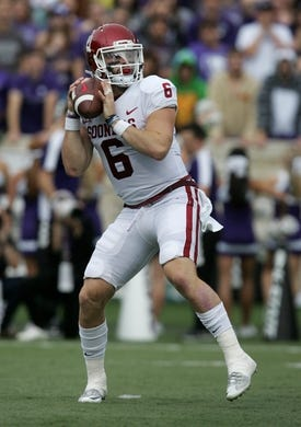 Oct 21, 2017; Manhattan, KS, USA; Oklahoma Sooners quarterback Baker Mayfield (6) drops back to pass during first quarter action against the Kansas State Wildcats at Bill Snyder Family Stadium. Mandatory Credit: Scott Sewell-USA TODAY Sports