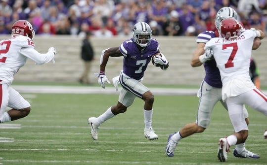 Oct 21, 2017; Manhattan, KS, USA; Kansas State Wildcats wide receiver Isaiah Zuber (7) looks for room to run after a catch in the first quarter against the Oklahoma Sooners at Bill Snyder Family Stadium. Mandatory Credit: Scott Sewell-USA TODAY Sports