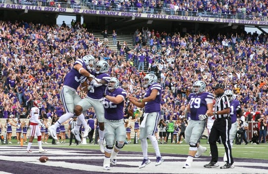 Oct 21, 2017; Manhattan, KS, USA; Kansas State Wildcats running back Alex Barnes (34) is congratulated by wide receiver Isaiah Zuber (7) after scoring a touchdown against the Oklahoma Sooners in the first quarter at Bill Snyder Family Stadium. Mandatory Credit: Scott Sewell-USA TODAY Sports