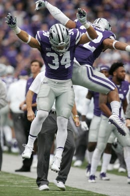 Oct 21, 2017; Manhattan, KS, USA; Kansas State Wildcats running back Justin Silmon (32) congratulates Alex Barnes (34) after Barnes scored a touchdown in the first quarter against the Oklahoma Sooners at Bill Snyder Family Stadium. Mandatory Credit: Scott Sewell-USA TODAY Sports