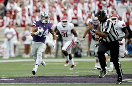 Oct 21, 2017; Manhattan, KS, USA; Kansas State Wildcats running back Alex Barnes (34) finds plenty of room to run during first-quarter action against the Oklahoma Sooners at Bill Snyder Family Stadium. The Sooners won the game 42-35. Mandatory Credit: Scott Sewell-USA TODAY Sports