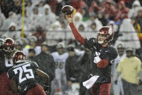 Oct 21, 2017; Pullman, WA, USA; Washington State Cougars quarterback Luke Falk (4) completes a pass against the Colorado Buffaloes during the first half at Martin Stadium. Mandatory Credit: James Snook-USA TODAY Sports