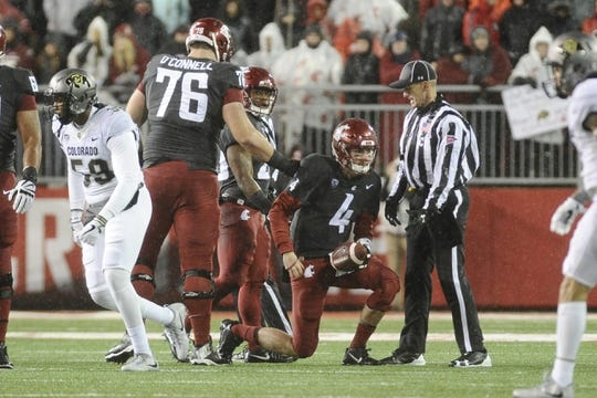 Oct 21, 2017; Pullman, WA, USA; Washington State Cougars quarterback Luke Falk (4) gets up after being tackled by the Colorado Buffaloes during the first half at Martin Stadium. Mandatory Credit: James Snook-USA TODAY Sports