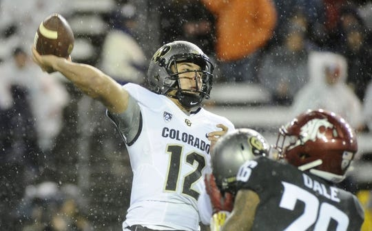 Oct 21, 2017; Pullman, WA, USA; Colorado Buffaloes quarterback Steven Montez (12) throws a pass against the Washington State Cougars during the first half at Martin Stadium. Mandatory Credit: James Snook-USA TODAY Sports