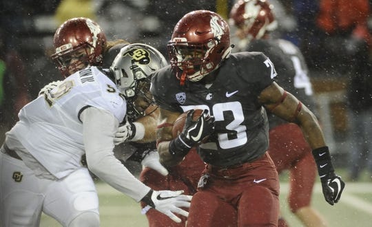 Oct 21, 2017; Pullman, WA, USA; Washington State Cougars running back Gerard Wicks (23) gets around the corner against Colorado Buffaloes defensive end Leo Jackson III (52) during the first half at Martin Stadium. Mandatory Credit: James Snook-USA TODAY Sports