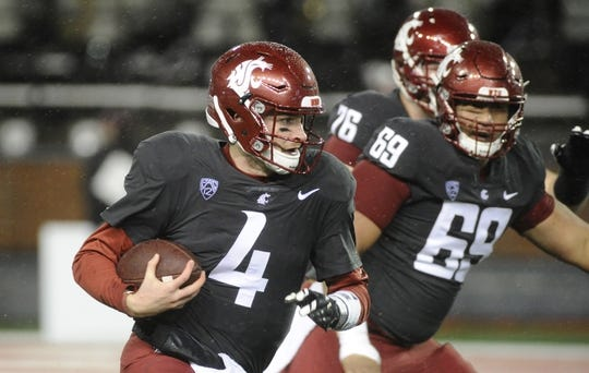 Oct 21, 2017; Pullman, WA, USA; Washington State Cougars quarterback Luke Falk (4) runs for a first down against the Colorado Buffaloes during the first half at Martin Stadium. Mandatory Credit: James Snook-USA TODAY Sports
