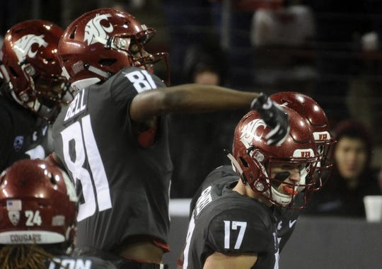Oct 21, 2017; Pullman, WA, USA; Washington State Cougars wide receiver Renard Bell (81) and Washington State Cougars wide receiver Kyle Sweet (17) celebrate a touchdown against the Colorado Buffaloes during the first half at Martin Stadium. Mandatory Credit: James Snook-USA TODAY Sports