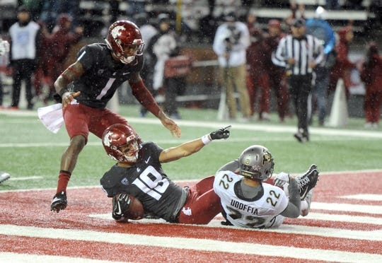 Oct 21, 2017; Pullman, WA, USA; Washington State Cougars wide receiver Brandon Arconado (19) and Washington State Cougars wide receiver Davontavean Martin (1) celebrate after scoring a touchdown against Colorado Buffaloes defensive back Trey Udoffia (22) during the first half at Martin Stadium. Mandatory Credit: James Snook-USA TODAY Sports