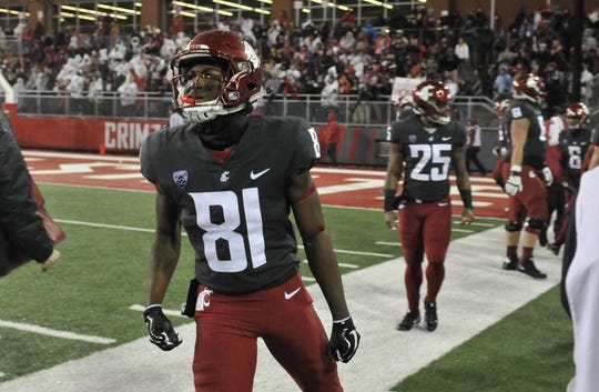 Oct 21, 2017; Pullman, WA, USA; Washington State Cougars wide receiver Renard Bell (81) celebrates a touchdown against the Colorado Buffaloes during the first half at Martin Stadium. Mandatory Credit: James Snook-USA TODAY Sports