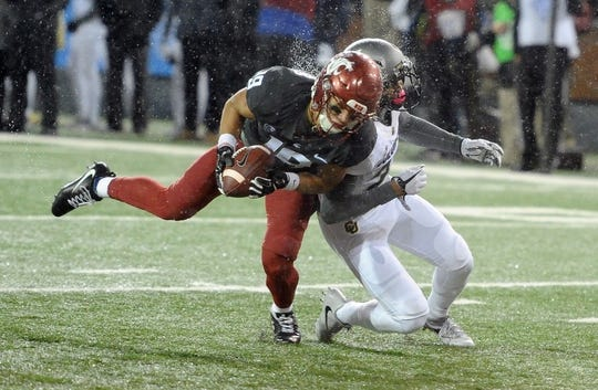 Oct 21, 2017; Pullman, WA, USA; (Editors Notes: Caption Correction) Washington State Cougars wide receiver Brandon Arconado (19) dives for the goal line against Colorado Buffaloes defensive back Trey Udoffia (22) during the first half at Martin Stadium. Mandatory Credit: James Snook-USA TODAY Sports