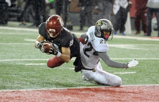 Oct 21, 2017; Pullman, WA, USA; (Editors Notes: Caption Correction) Washington State Cougars wide receiver Brandon Arconado (19) scores a touchdown against Colorado Buffaloes defensive back Trey Udoffia (22) during the first half at Martin Stadium. Mandatory Credit: James Snook-USA TODAY Sports