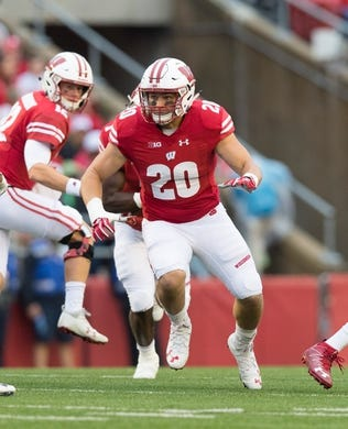 Oct 14, 2017; Madison, WI, USA; Wisconsin Badgers fullback Austin Ramesh (20) during the game against the Purdue Boilermakers at Camp Randall Stadium. Mandatory Credit: Jeff Hanisch-USA TODAY Sports