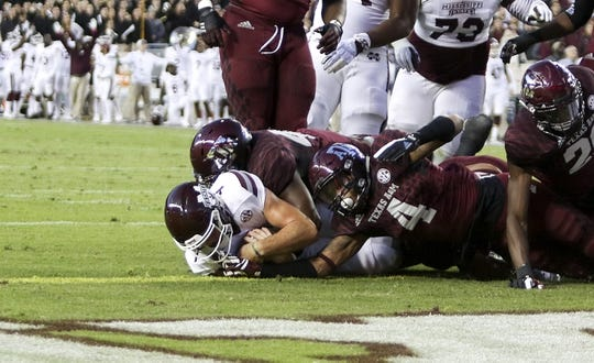 Oct 28, 2017; College Station, TX, USA; Mississippi State Bulldogs quarterback Nick Fitzgerald (7) scores on a two yard touchdown in the first quarter against the Texas A&M Aggies at Kyle Field. Mandatory Credit: John Glaser-USA TODAY Sports