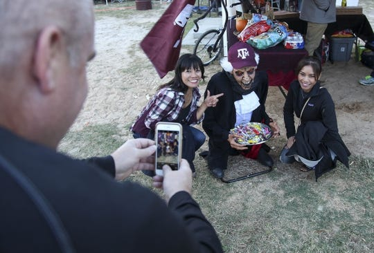 Oct 28, 2017; College Station, TX, USA; Texas A&M Aggies fans have their photo taken with Halloween decorations in the tailgate area prior to the start of the game against the Texas A&M Aggies and Mississippi State Bulldogs at Kyle Field. Mandatory Credit: John Glaser-USA TODAY Sports