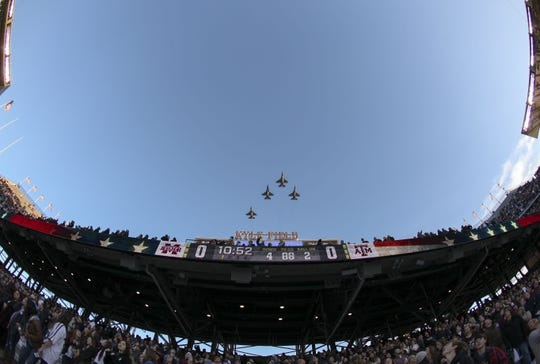 Oct 28, 2017; College Station, TX, USA; F-16 Fighting Falcons from the 182nd fighter squadron fly over Kyle Field during the national anthem before a game between the Texas A&M Aggies and the Mississippi State Bulldogs. Mandatory Credit: John Glaser-USA TODAY Sports