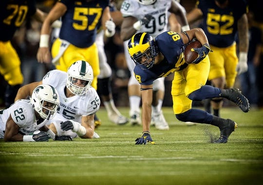 Oct 7, 2017; Ann Arbor, MI, USA; Michigan Wolverines wide receiver Grant Perry (88) runs for yards after a catch during the first quarter of a game against the Michigan State Spartans at Michigan Stadium. Mandatory Credit: Mike Carter-USA TODAY Sports