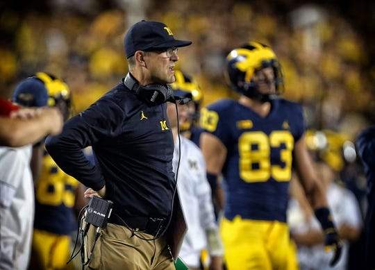 Oct 7, 2017; Ann Arbor, MI, USA; Michigan Wolverines head coach Jim Harbaugh stands on the sidelines during the first quarter of a game against the Michigan State Spartans at Michigan Stadium. Mandatory Credit: Mike Carter-USA TODAY Sports
