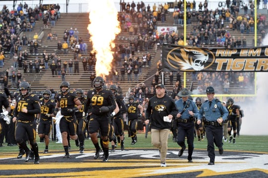 Nov 4, 2017; Columbia, MO, USA; Missouri Tigers head coach Barry Odom runs onto the field with players before the game against the Florida Gators at Faurot Field. Mandatory Credit: Denny Medley-USA TODAY Sports