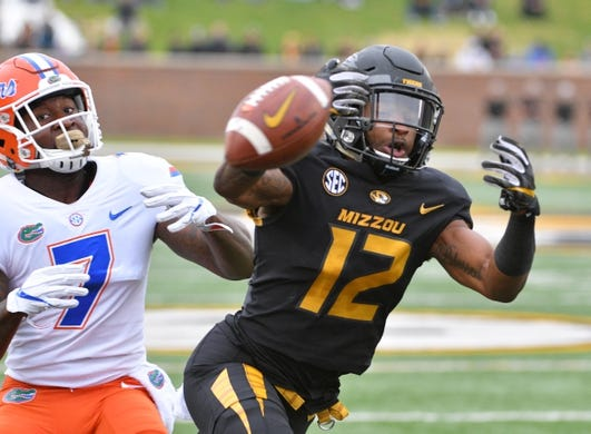Nov 4, 2017; Columbia, MO, USA; Missouri Tigers wide receiver Johnathon Johnson (12) can't make the catch as Florida Gators defensive back Duke Dawson (7) defends during the first half at Faurot Field. Mandatory Credit: Denny Medley-USA TODAY Sports