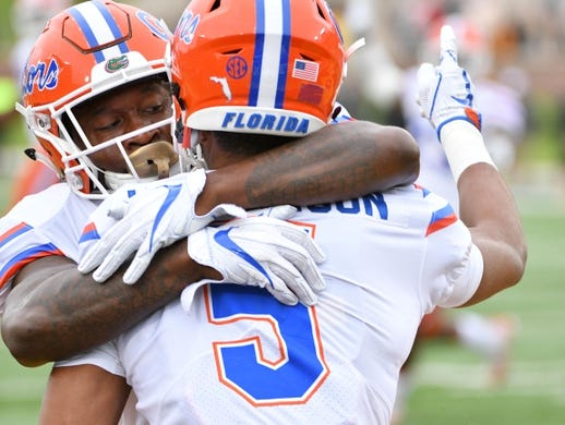 Nov 4, 2017; Columbia, MO, USA; Florida Gators cornerback CJ Henderson (5) is congratulated by defensive back Duke Dawson (7) after Henderson intercepted a pass during the first half against the Missouri Tigers at Faurot Field. Mandatory Credit: Denny Medley-USA TODAY Sports