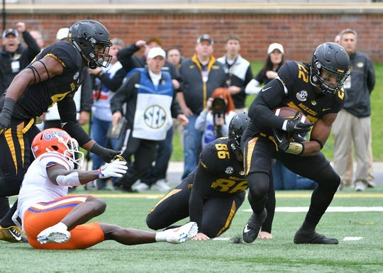 Nov 4, 2017; Columbia, MO, USA; Missouri Tigers defensive back Anthony Sherrils (22) recovers a fumble by Florida Gators wide receiver Brandon Powell (4) during the first half at Faurot Field. Mandatory Credit: Denny Medley-USA TODAY Sports