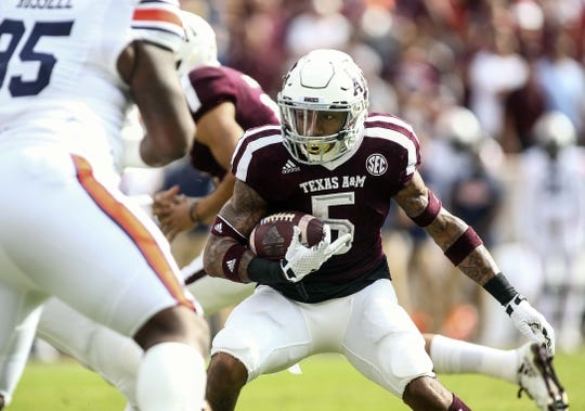 Nov 4, 2017; College Station, TX, USA; Texas A&M Aggies running back Trayveon Williams (5) runs with the ball during the first quarter against the Auburn Tigers at Kyle Field. Mandatory Credit: Troy Taormina-USA TODAY Sports