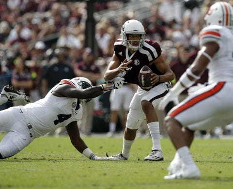 Nov 4, 2017; College Station, TX, USA; Texas A&M Aggies quarterback Kellen Mond (11) is sacked by Auburn Tigers linebacker Jeff Holland (4) in the first quarter at Kyle Field. Mandatory Credit: Erich Schlegel-USA TODAY Sports