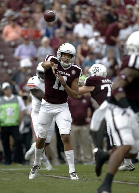 Nov 4, 2017; College Station, TX, USA; Texas A&M Aggies quarterback Kellen Mond (11) throws against the Auburn Tigers in the first quarter at Kyle Field. Mandatory Credit: Erich Schlegel-USA TODAY Sports
