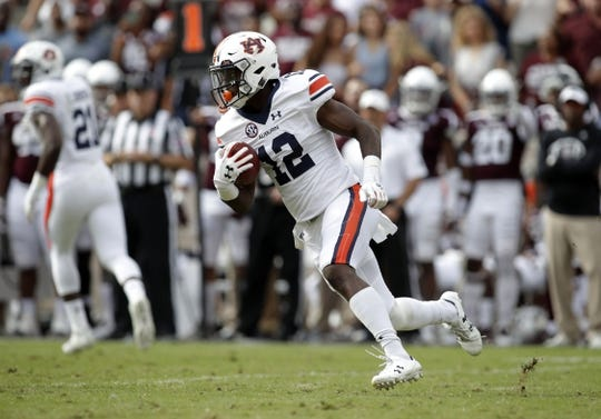 Nov 4, 2017; College Station, TX, USA; Auburn Tigers wide receiver Eli Stove (12) runs a reverse against the Texas A&M Aggies in the first quarter at Kyle Field. Mandatory Credit: Erich Schlegel-USA TODAY Sports