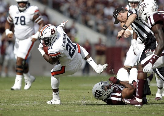 Nov 4, 2017; College Station, TX, USA; Auburn Tigers running back Kerryon Johnson (21) is stopped by the Texas A&M Aggies in the first quarter at Kyle Field. Mandatory Credit: Erich Schlegel-USA TODAY Sports