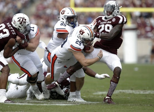 Nov 4, 2017; College Station, TX, USA; Auburn Tigers' Tyler Stovall tries to get a first down on a fake field goal keeper against Texas A&M Aggies defensive back Debione Renfro (29) at Kyle Field. Mandatory Credit: Erich Schlegel-USA TODAY Sports