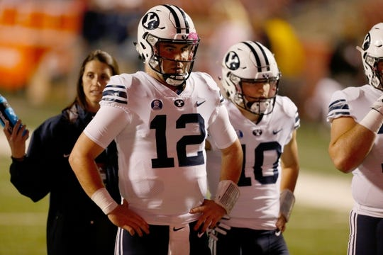 Nov 4, 2017; Fresno, CA, USA; Brigham Young Cougars quarterback Tanner Mangum (12) warms up before the start of the game against the Fresno State Bulldogs at Bulldog Stadium. Mandatory Credit: Kiel Maddox-USA TODAY Sports
