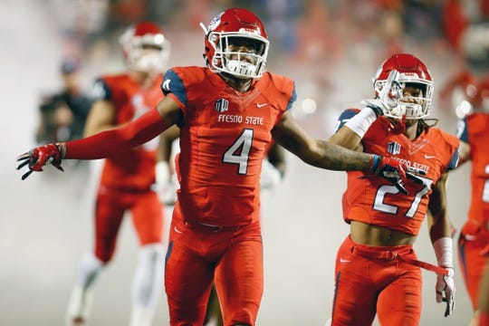 Nov 4, 2017; Fresno, CA, USA; Fresno State Bulldogs defensive back Mike Bell (4) rushes onto the field before the start of a game against the Brigham Young Cougars at Bulldog Stadium. Mandatory Credit: Kiel Maddox-USA TODAY Sports