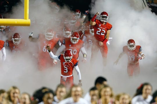 Nov 4, 2017; Fresno, CA, USA; The Fresno State Bulldogs rush onto the field before the start of a game against the Brigham Young Cougars at Bulldog Stadium. Mandatory Credit: Kiel Maddox-USA TODAY Sports