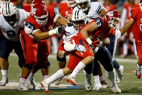 Nov 4, 2017; Fresno, CA, USA; Fresno State Bulldogs running back Josh Hokit (33) rushes the ball in the first quarter against the Brigham Young Cougars at Bulldog Stadium. Mandatory Credit: Kiel Maddox-USA TODAY Sports