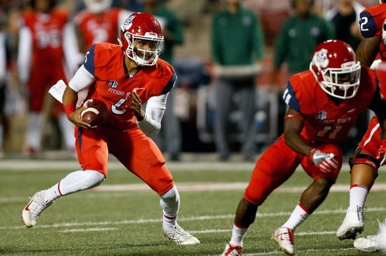 Nov 4, 2017; Fresno, CA, USA; Fresno State Bulldogs quarterback Marcus McMaryion (6) rushes the football during the first quarter against the Brigham Young Cougars at Bulldog Stadium. Mandatory Credit: Kiel Maddox-USA TODAY Sports