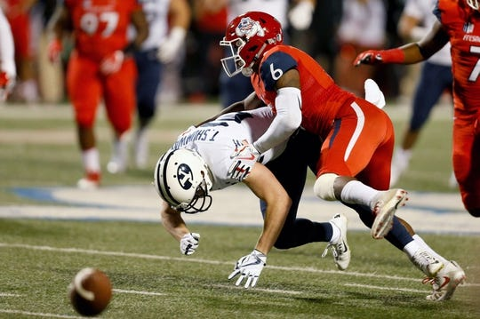 Nov 4, 2017; Fresno, CA, USA; Fresno State Bulldogs defensive back Tank Kelly (6) breaks up a catch against Brigham Young Cougars wide receiver Talon Shumway (21) during the first quarter at Bulldog Stadium. Mandatory Credit: Kiel Maddox-USA TODAY Sports