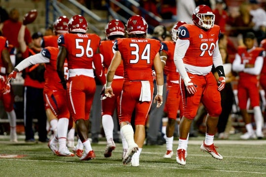 Nov 4, 2017; Fresno, CA, USA; Fresno State Bulldogs defensive linemen Kevin Atkins (90) reacts after a fourth down stop during the first quarter against the Brigham Young Cougars at Bulldog Stadium. Mandatory Credit: Kiel Maddox-USA TODAY Sports