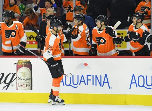 Nov 9, 2017; Philadelphia, PA, USA; Philadelphia Flyers center Claude Giroux (28) celebrates his goal with teammates against the Chicago Blackhawks during the first period at Wells Fargo Center. Mandatory Credit: Eric Hartline-USA TODAY Sports