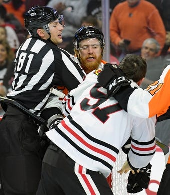 Nov 9, 2017; Philadelphia, PA, USA; Philadelphia Flyers right wing Jakub Voracek (93) and Chicago Blackhawks right wing Tommy Wingels (57) during the first period at Wells Fargo Center. Mandatory Credit: Eric Hartline-USA TODAY Sports